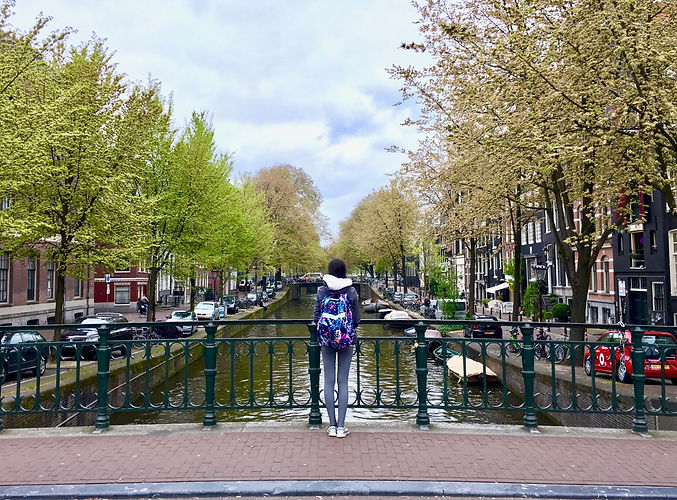 Eryn overlooks a canal in Amsterdam, the Netherlands from a bridge