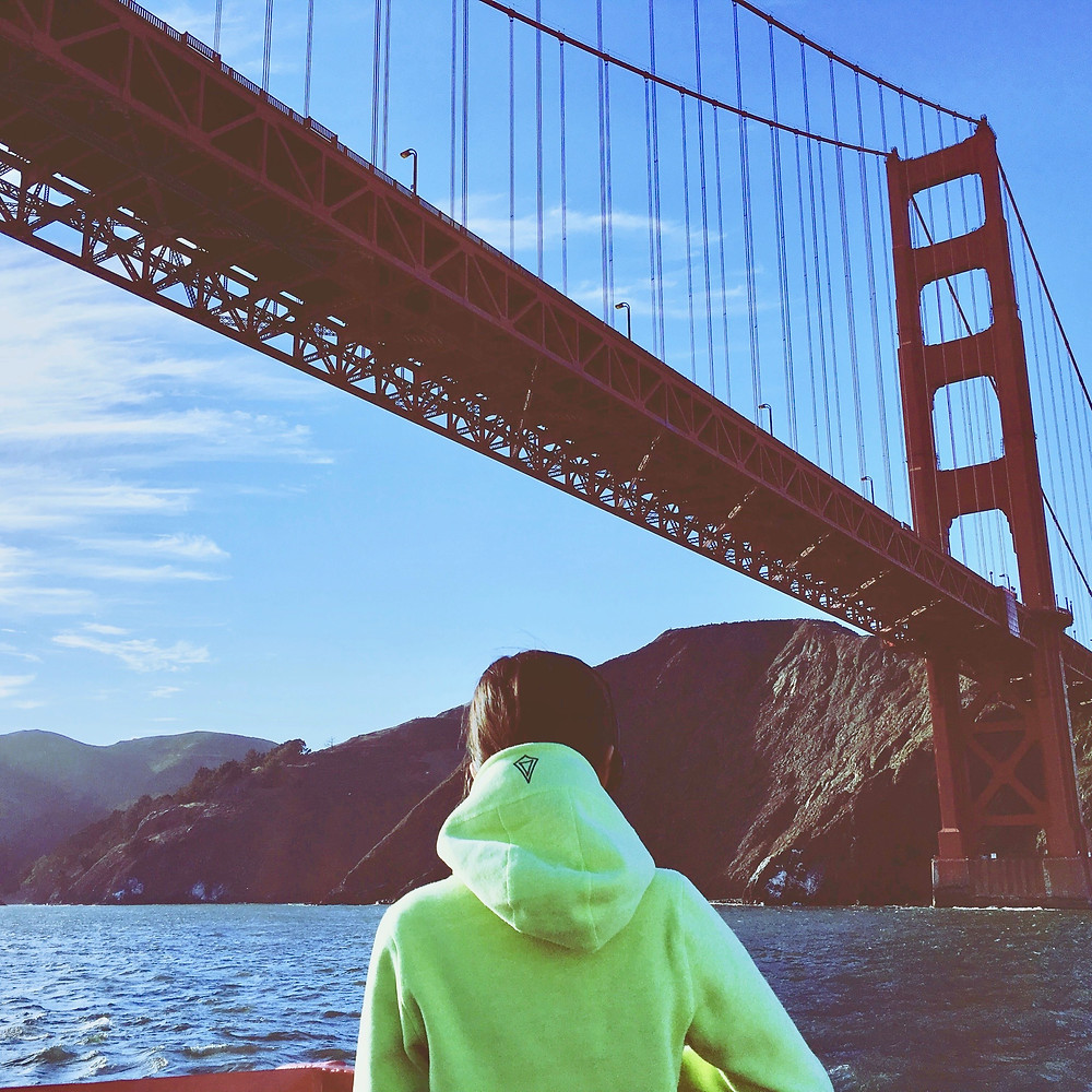 Eryn looks out to San Francisco's Golden Gate Bridge from a boat in the water below