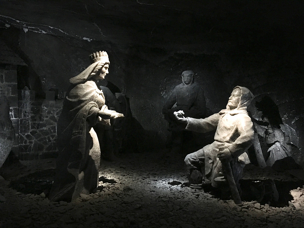 Salt sculptures of St. Kinga and a miner finding her engagement ring in the Wieliczka Salt Mine