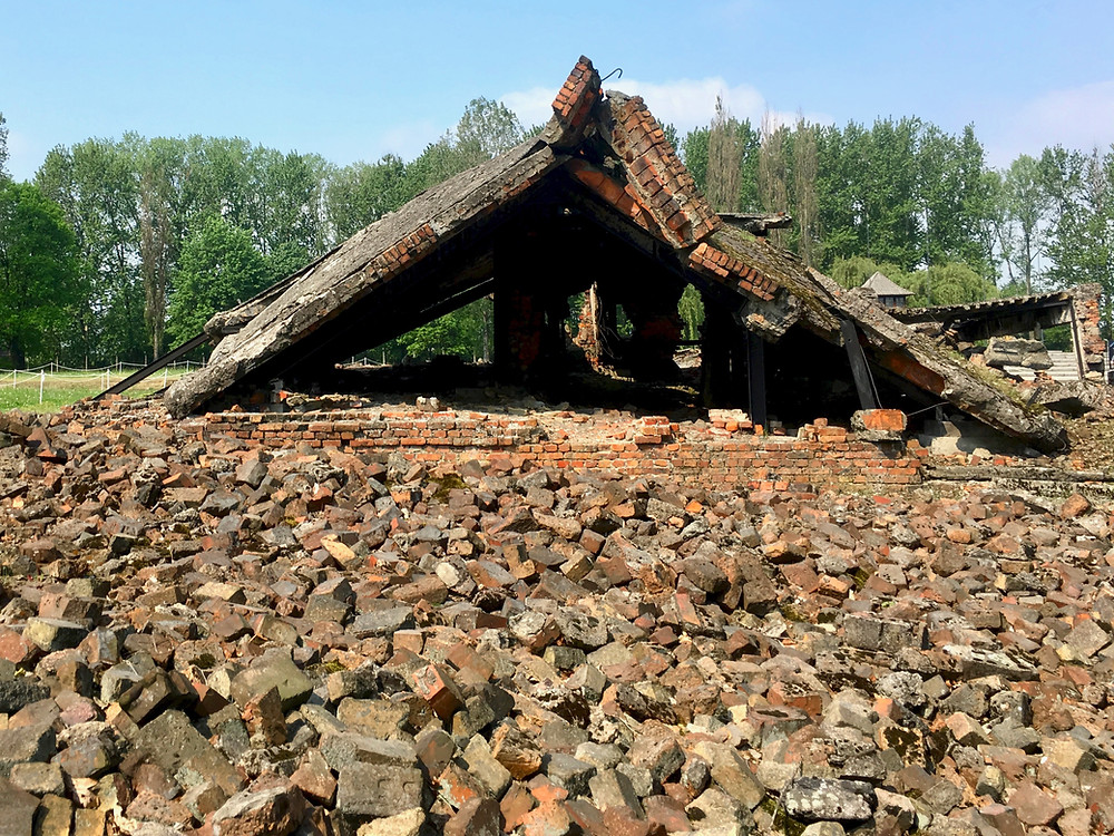 The remains of a ruined brick structure before the brick-covered ground at Auschwitz II