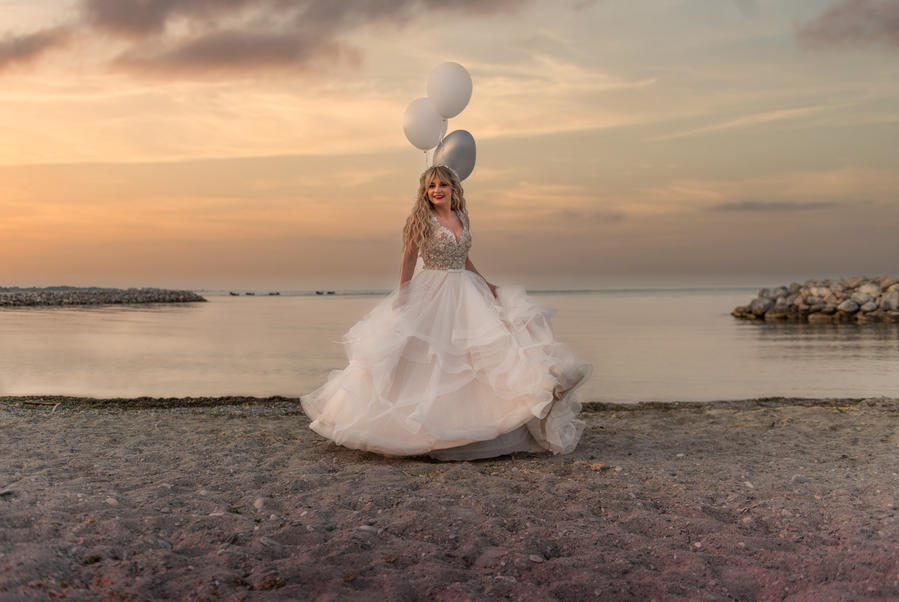 Bride at beach with balloons.jpg