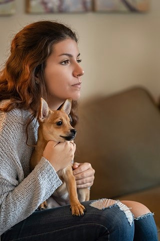 Girl on couch with dog.jpg
