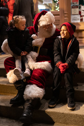 Baoy and girl with santa.jpg