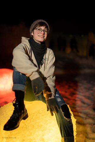 Girl on lighted rock.jpg