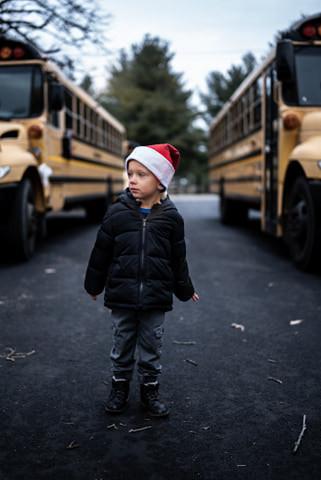 Boy Between Busses.jpg