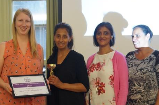 Grove staff collecting their Ealing Partnership award