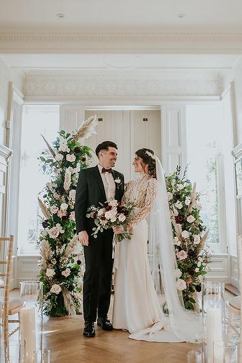 Bride and Groom Floral Columns.jpg