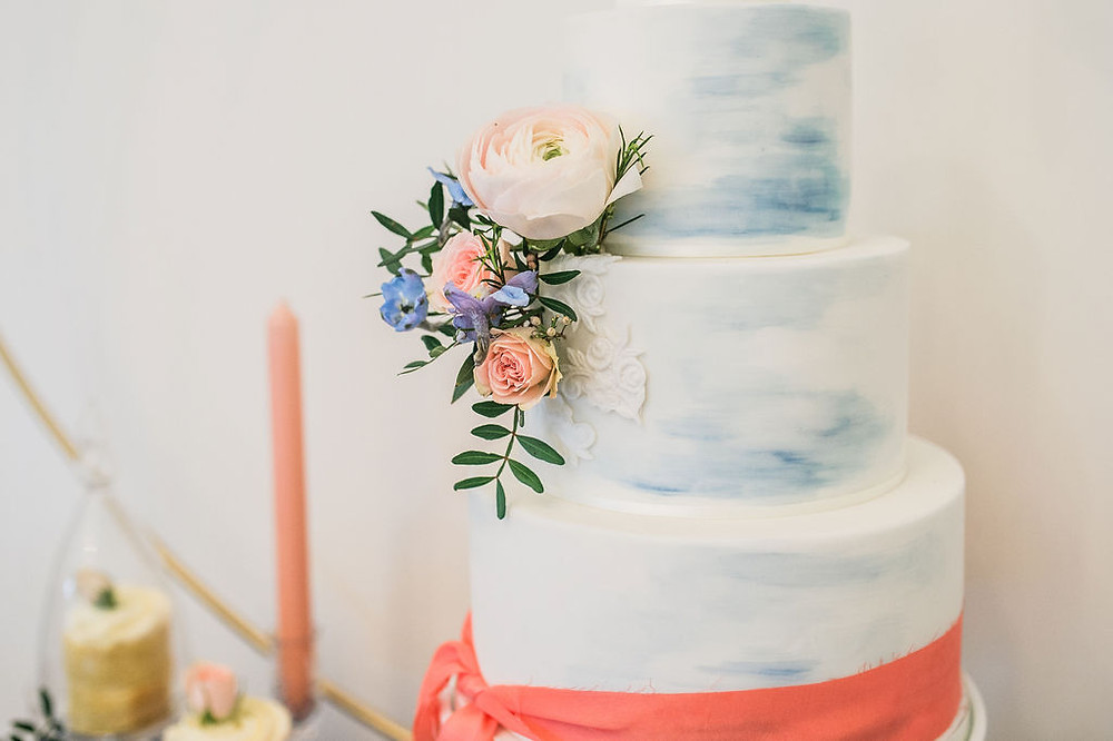 Watercolour brushed wedding cake with lace detailing and fresh flowers from Pinkface.