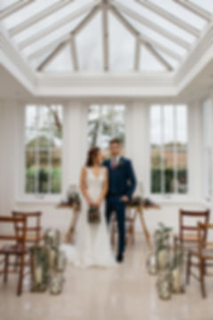 Boho luxe bride and groom in civil cereony at Downham Hall Essex. Tables and chairs from Anthology Vintage Hire. Styling and lanterns from Party Squared. Floral table runner by The Botanical Shed.