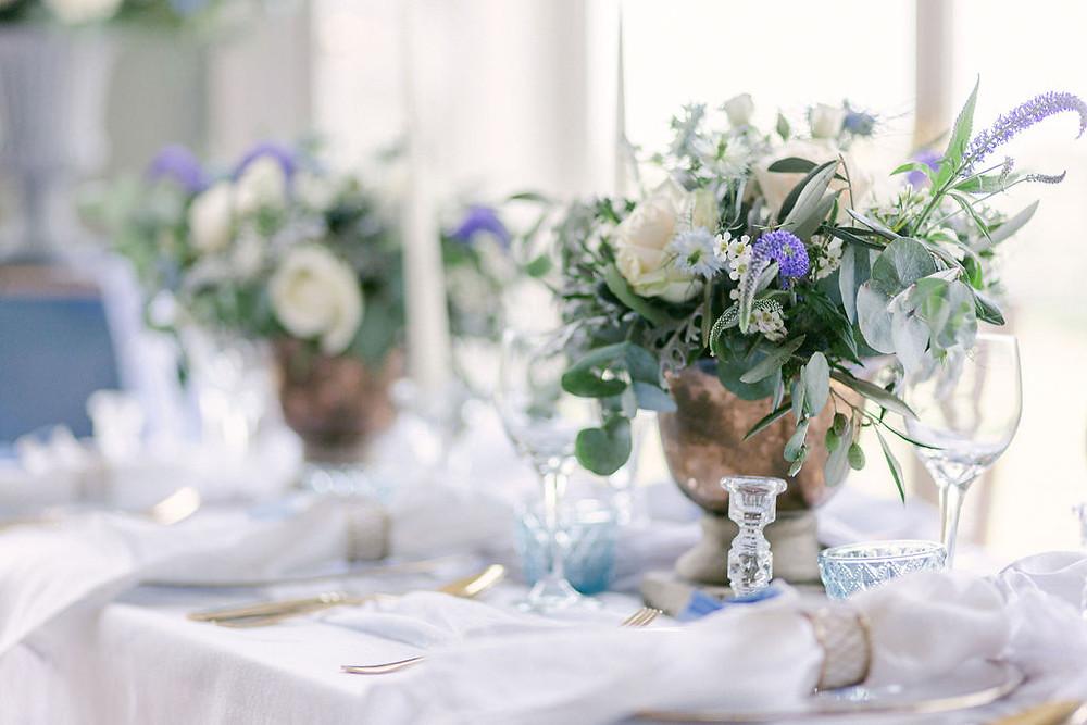 Wedding table centrepiece at Hylands House Wedding Venue in Essex