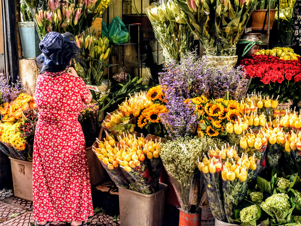 Local buying flowers at market