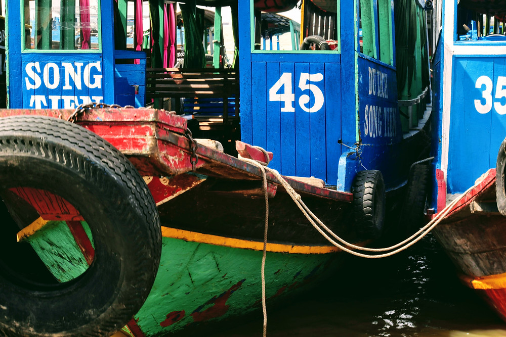 blue boats on mekong delta