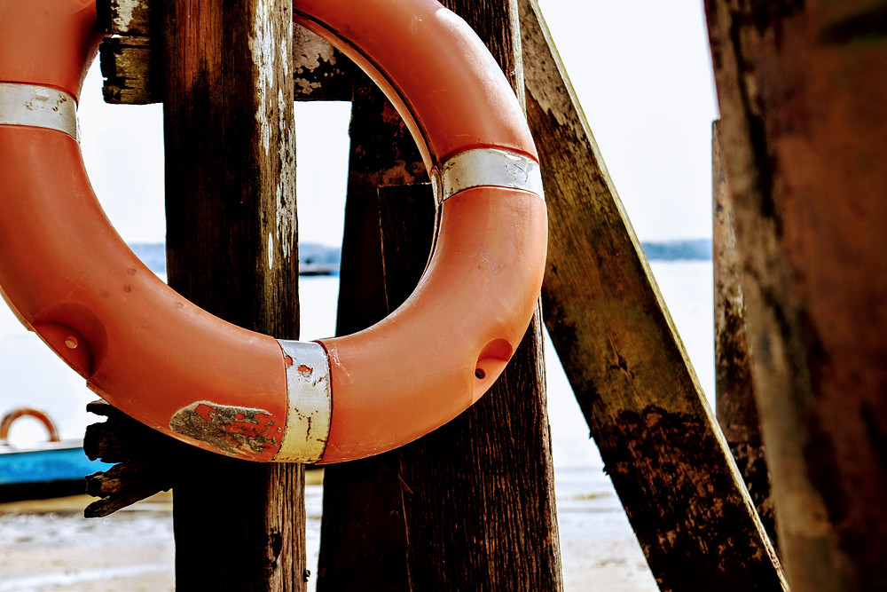 close up of wooden pier with flotation device