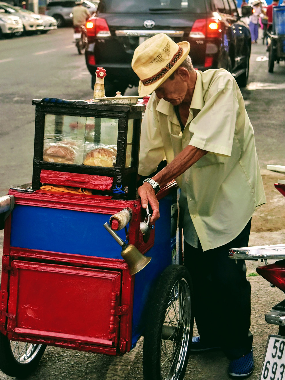 Street food vendor in Saigon Vietnam