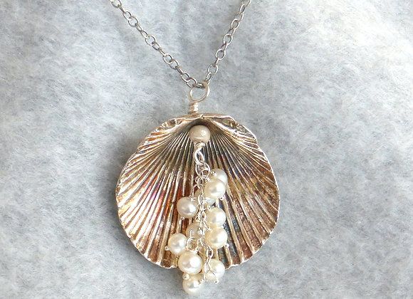 Seashell with Cascading Pearls