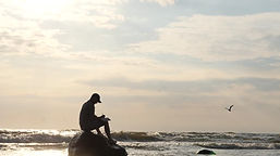 Man writting on beach.jpg