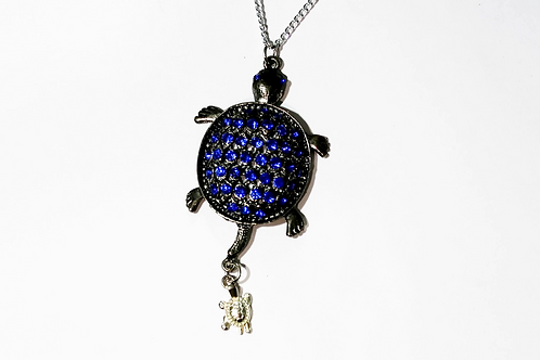 Blue turtle with hanging turtle charm necklace