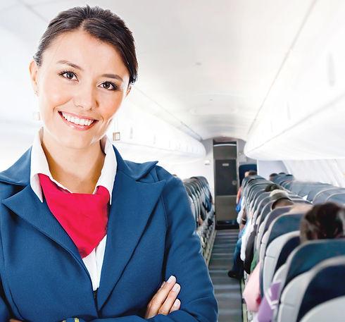Beautiful flight attendant in an airplan