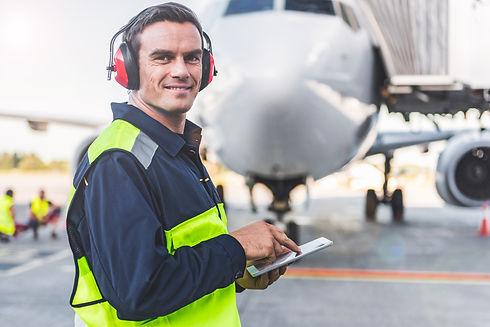 Happy mechanic having job in airdrome.jp