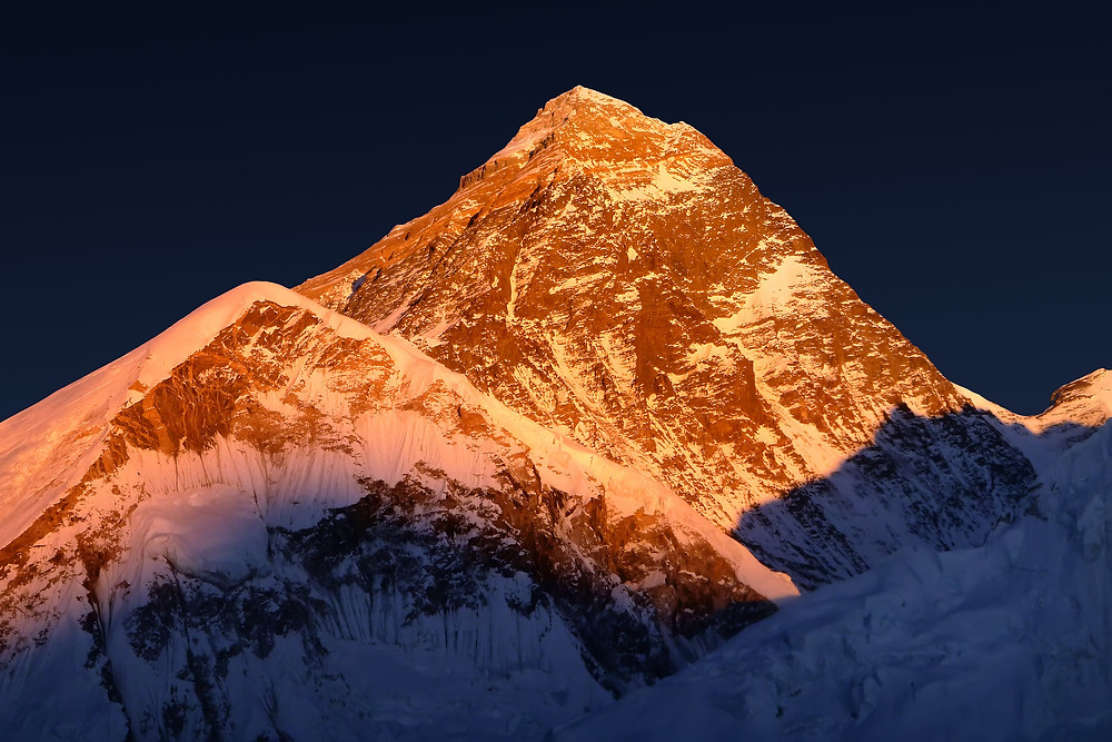 The peak of the highest mountain in the world - Mt. Everest at the sunset.