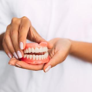 Dentures and denture stabilisation