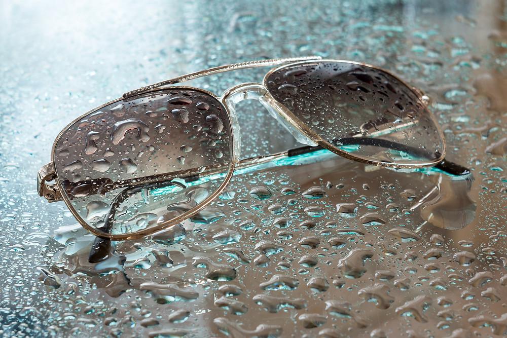 wet sunglasses on glass floor