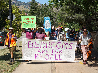 The fight's not over: Bedrooms Are For People marched Saturday through Boulder