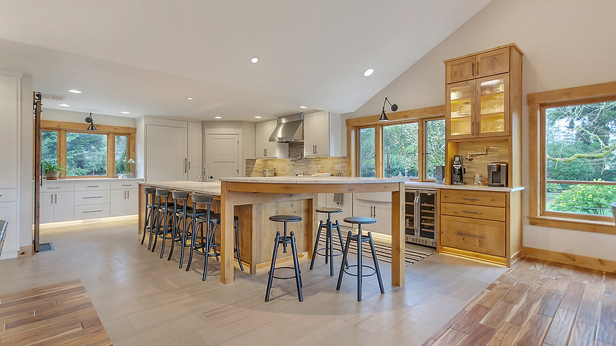 Modern kitchen with rustic finishes. Transitional kitchen and stained woodwork. Painted cabinetry, custom cabinets.