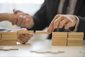 Teamwork or building bridges concept wit