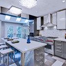 """""""Pay special attention to the kitchen island which can often become a casual family gathering space, where breakfast is eaten in the morning, homework is done in the evening and casual snacks are shared throughout the weekend.""""   """"Use elegant, man-made countertops that are three centimeters thick. This size is preferable, because it falls between the size of the double thickness commonly used with natural stone and the thin look more suitable for a clean-line contemporary look. At this thickness, it can be polished repeatedly to last a lifetime."""" READ MORE:"""
