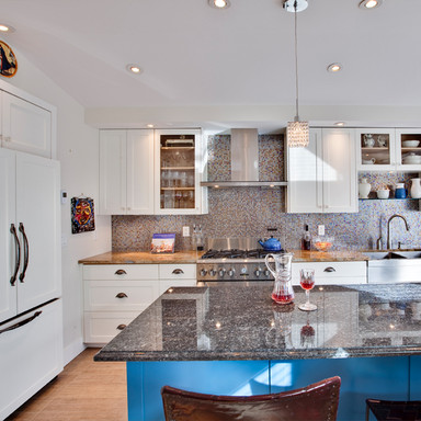 """Pay special attention to the kitchen island which can often become a casual family gathering space, where breakfast is eaten in the morning, homework is done in the evening and casual snacks are shared throughout the weekend.""   ""Use elegant, man-made countertops that are three centimeters thick. This size is preferable, because it falls between the size of the double thickness commonly used with natural stone and the thin look more suitable for a clean-line contemporary look. At this thickness, it can be polished repeatedly to last a lifetime."" READ MORE:"