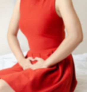 Women wear red skirt Use the hand to scratch the vagina.Genital itching caused by fungus in underwea