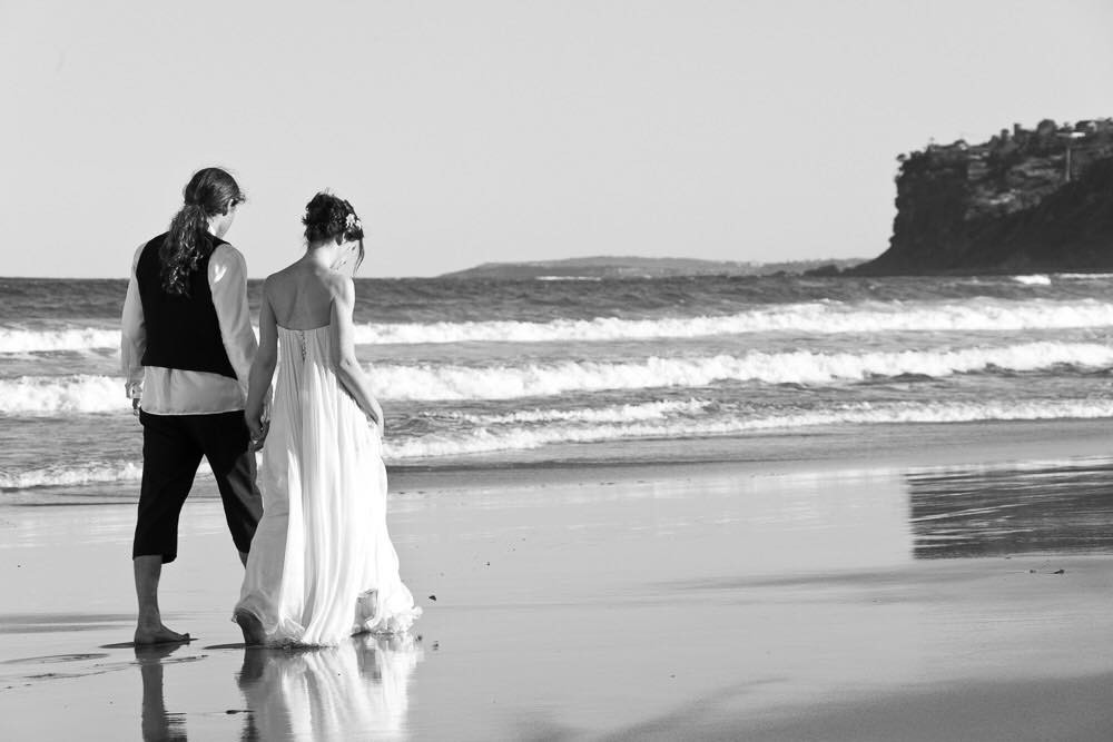 Husband and wife walking on the beach