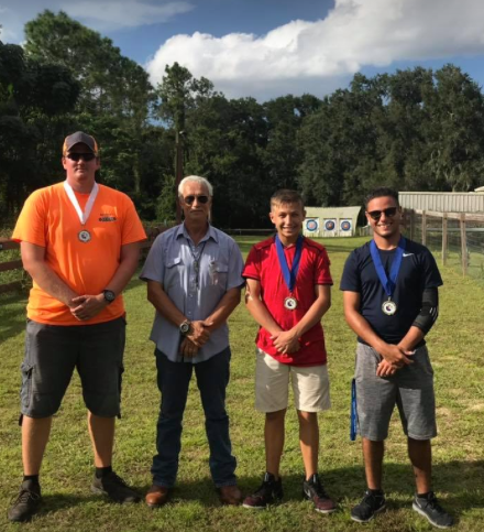 Coach Gouws and his recurve medalists