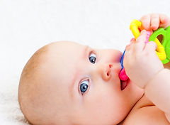 baby chewing on a toy