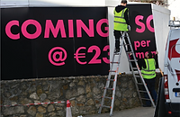 Fitters installing signage
