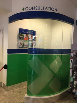 Pharmacy Consultation Area_Printed Graphics Applied to Glass_Custom Leaflet Holder Wall Unit
