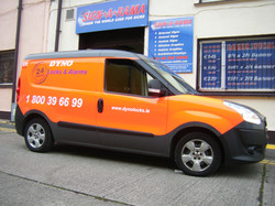 Vehicle Partial Wrap with Orange  Cast Vinyl Graphics onto White Vehicle