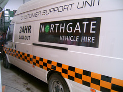 Heavily Branded Van with Reflective Stripping and Logo in Vinyl