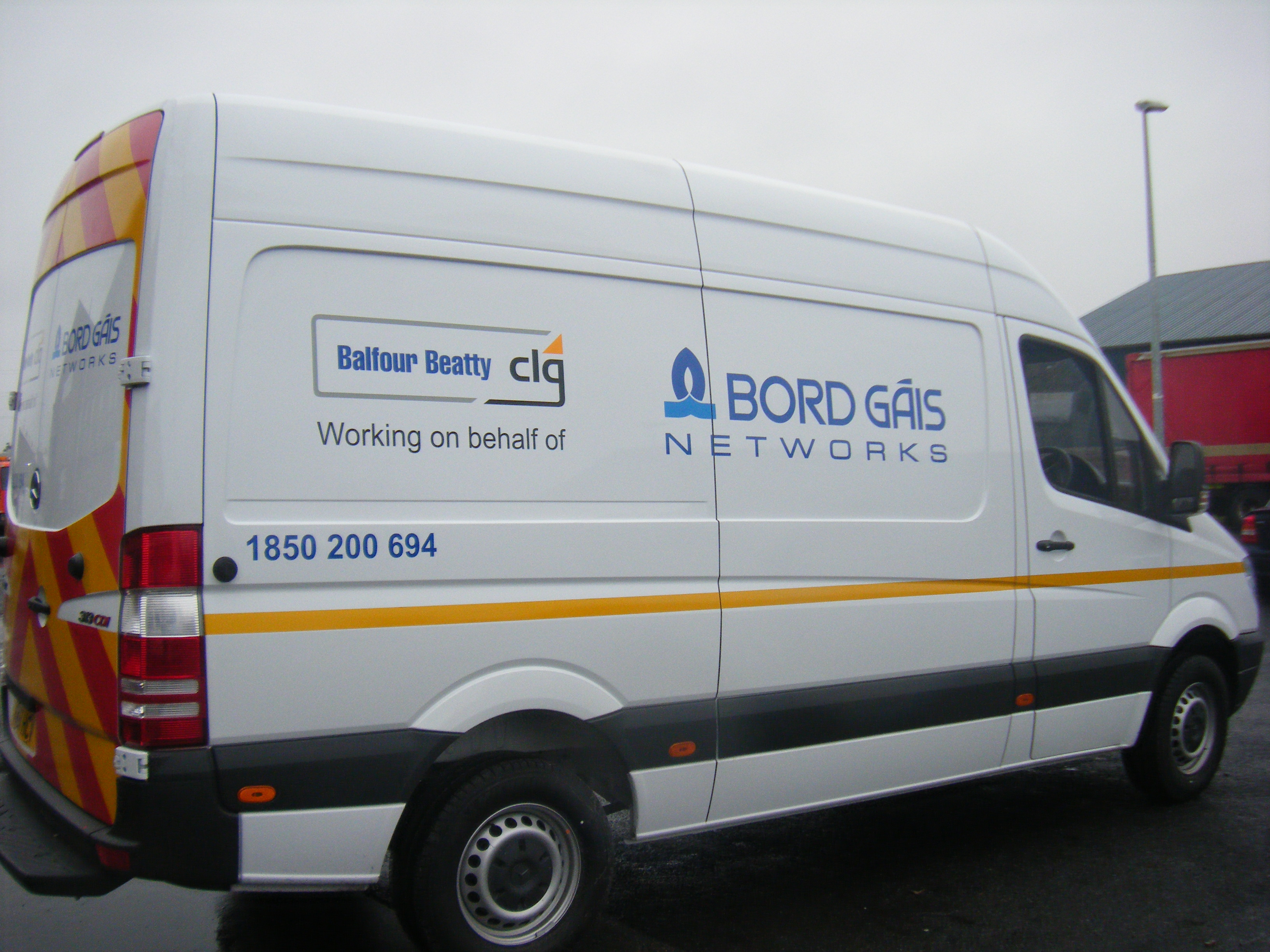 Vehicle Graphics_Simple Decal Logos with Reflective Strip
