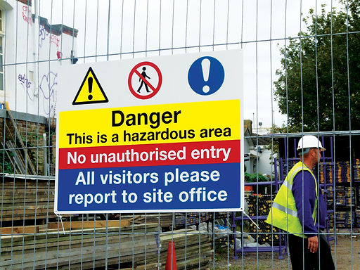 Safety sign on site fence