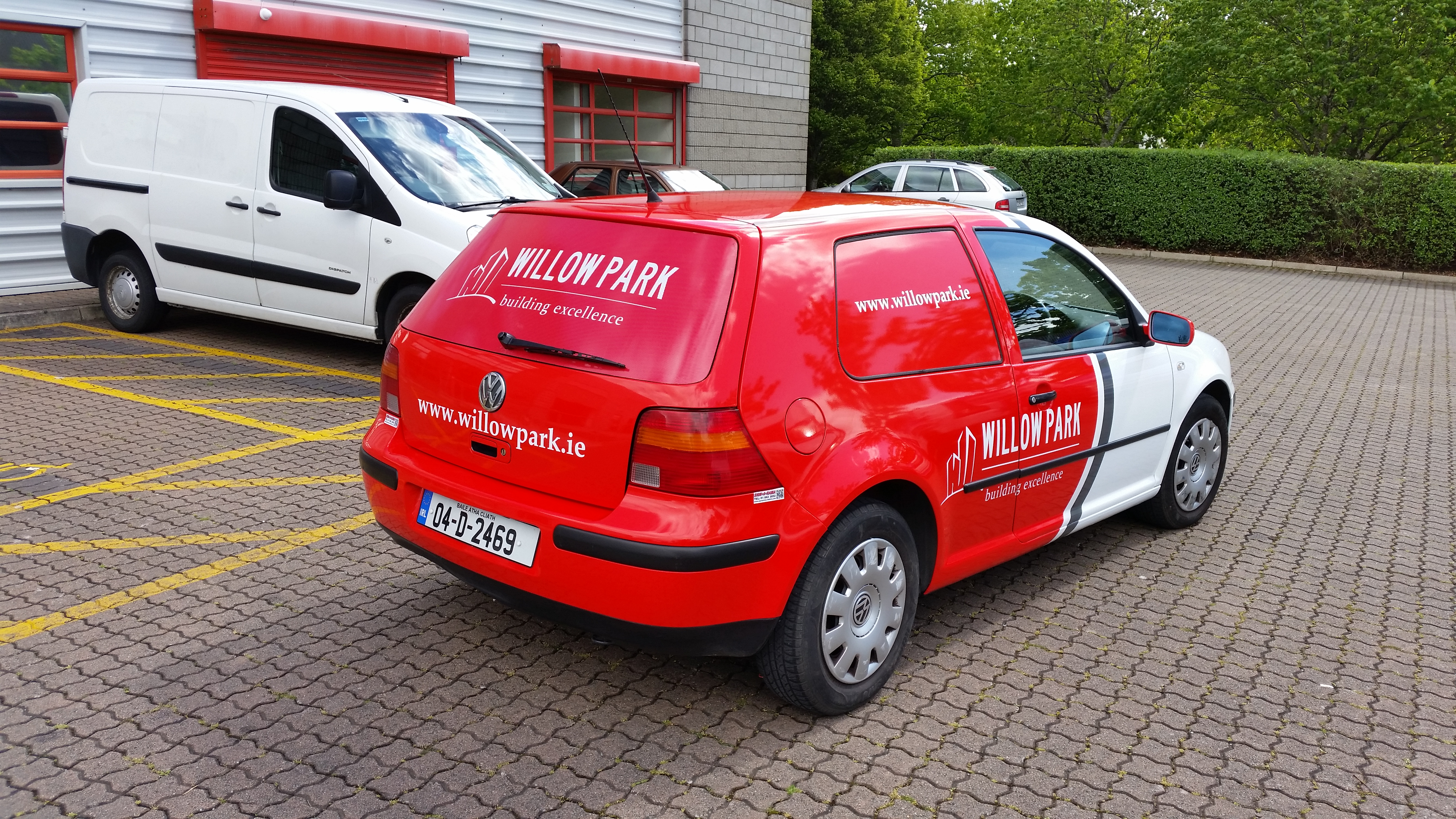 Vehicle Partial Wrap with Red Cast Vinyl Graphics onto White Vehicle