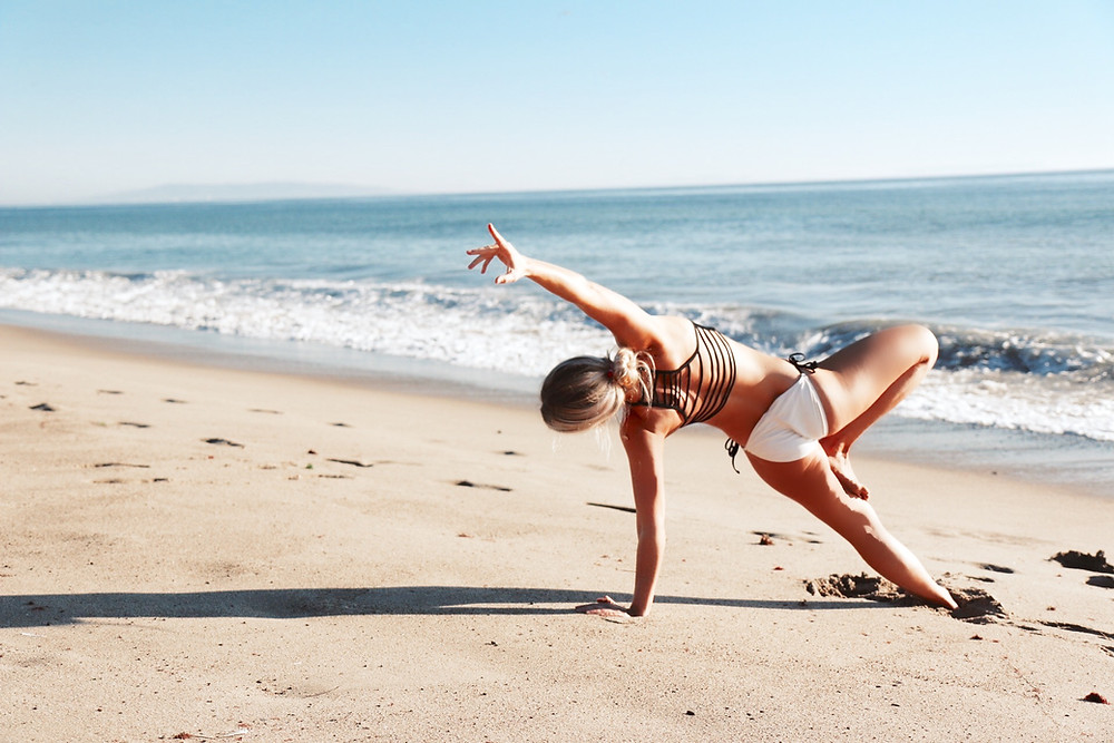 Tarah does yoga on the beach in Los Angeles