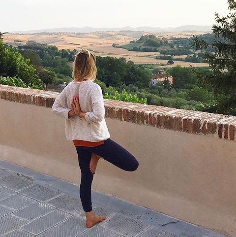 yoga teacher, yoga teacher london, tree pose, heart opener. balancing pose