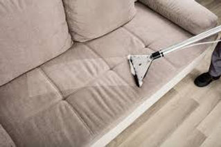 Steam cleaning couch upholstery.