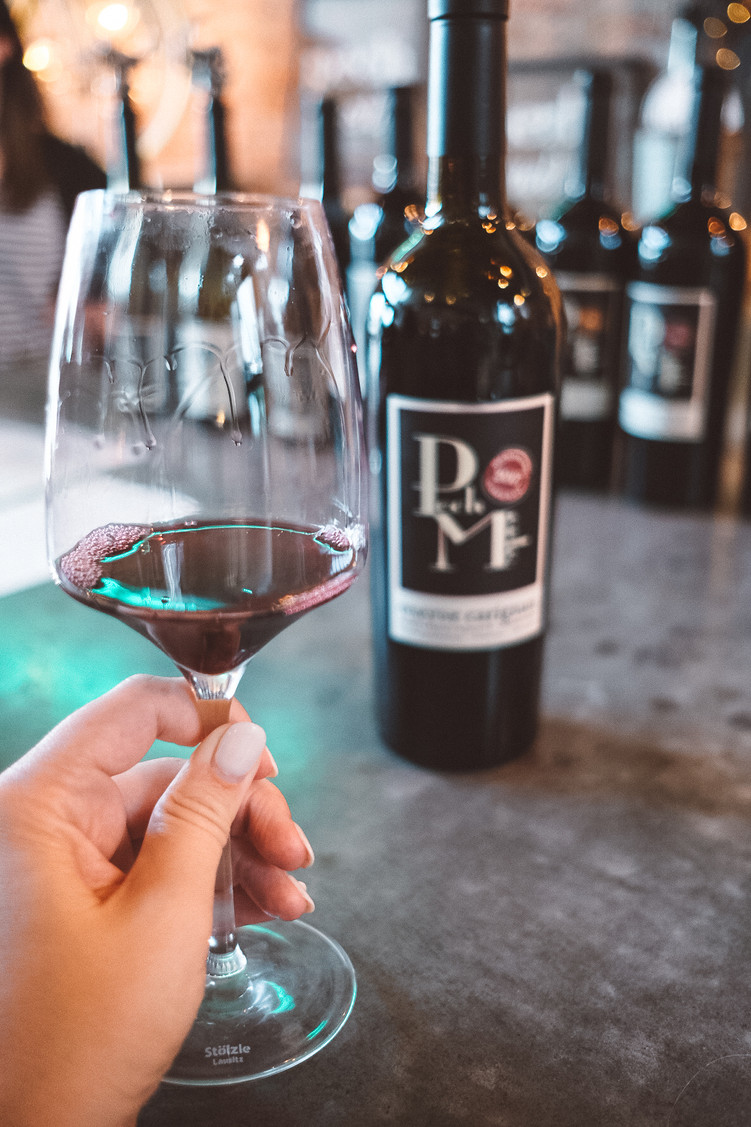 Sipping some red wine at Pech Merle Winery in Geyserville, California