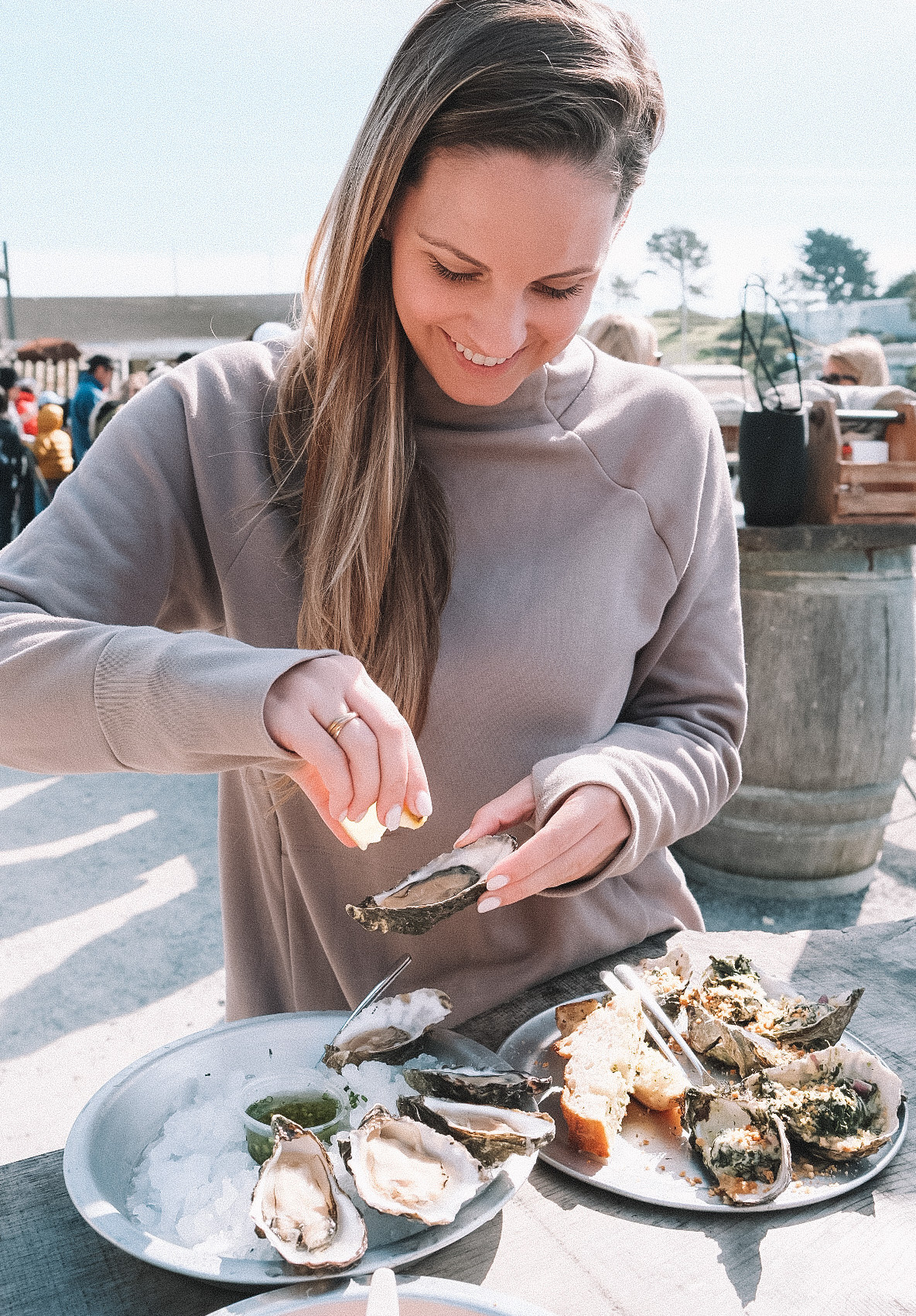 young woman enjoying fresh oysters on the northern California Coast