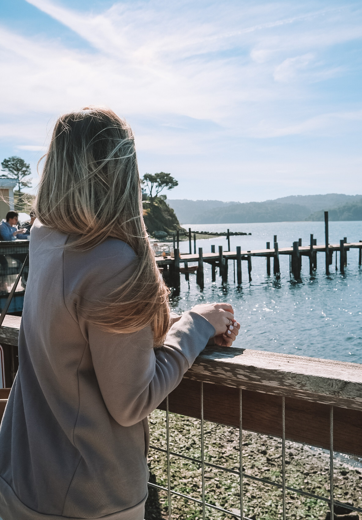 young woman taking in the view of the Northern California bay
