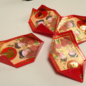 Now take four more wrappers and repeat for the bottom of the lantern.