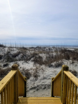 Dunes and beach at the end of the walkway